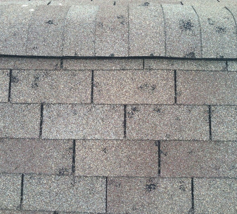 A roof that sustained hail damage after a severe storm
